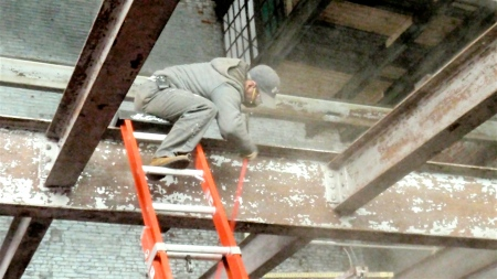 Javier Teran will put the finishes on the walls once they're ready. Here he's cleaning the beams, which he'll seal later so they're Look At Me worthy.