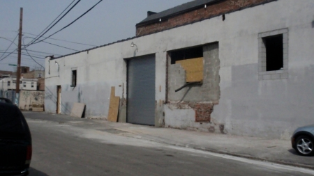 The new garage door on Palmer Street. It'll open into the warehouse. The windows will be glass block with vents. The large, unfinished opening will have a single door, no window.