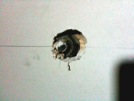 Drywall cannot hide everything. Here, this bolt couldn't be covered so we had to work around it.