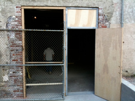 The front door's in place. There will be glass block filling the space to the left of the door.