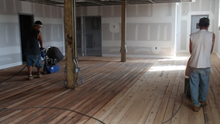 Sanding the wood floors in the offices. Polyurethane to follow.