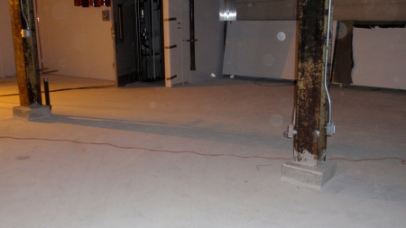 The concrete floor gets sanded, polished and then sealed.